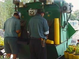 Comet_potting_machine_with_2_persons