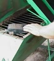 Hand_operation_of_fertiliser_activator_for_large_pots