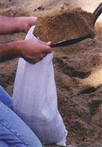 Filling sand bags by hand - watch those knuckles
