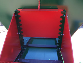 Chute opening showing chain drive with slats