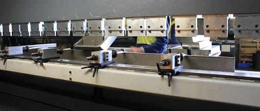 Bending metal in CNC brake press