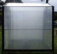 greenhouse-with-woven-fabric-cover-on